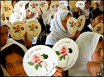 Afghan schoolgirls distributing stickers