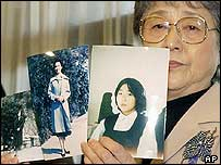 Sakie Yokota, whose daughter Megumi was abducted by North Korea, shows three photos provided by North Korea of her daughter  (file photo)