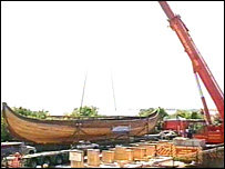 The Viking ship is lifted back into place