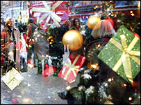 Christmas shoppers, tree and presents
