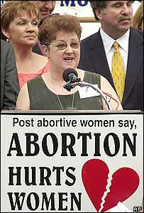 Norma McCorvey, the Jane Roe of the landmark case, addresses an anti-abortion rally in 2003