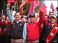 Leader of the Nationalist Party Lien Chan, center left, and leader of the People First Party James Soong, center right, march with supporters during a campaign for the upcoming poll