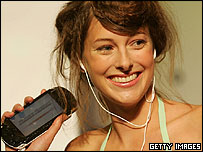 Image of a woman with a Sony PlayStation Portable