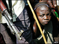 A child surrounded by soldiers in the Democratic Republic of Congo