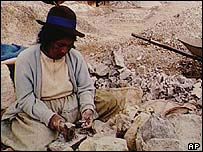 Andean woman working in a mine
