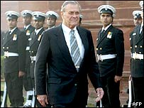 Donald Rumsfeld reviews an honour guard outside the defence ministry