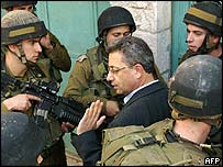 Barghouti surrounded by Israeli soldiers in the West Bank town of Hebron. Archive picture
