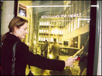 Woman using the interactive poster, Hypertag