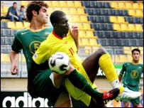 Benin's Razak Omotoyossi battles with Australia's Jacob Timpano