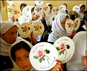 Girls from the Qala-E-Zaman Khan primary school show stickers asking for Cantoni's release.