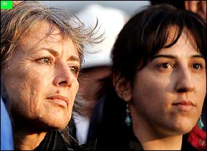 Former Italian hostages Giuliana Sgrena (L) and Simona Torretta take part at a candlelit vigil for Clementina Cantoni.
