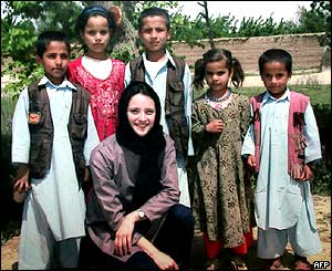 Cantoni with Afghan children