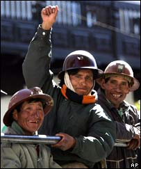 Bolivian miners celebrate the new president, Eduardo Rodriguez