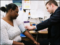 Photo of woman having her blood pressure checked