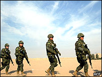 Soldiers from the Japanese Ground Self Defense Force(JGSDF) take part in a drill at a desert in Northern Kuwait, 16 November 2004.