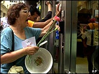 Demonstrators bang on the door of a bank in Buenos Aires in 2002