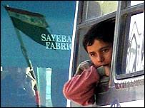 Refugees aboard bus