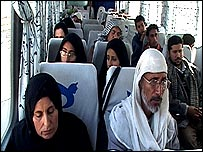 Iraqi refugees aboard bus