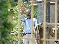 Hailu Shawel behind the gate of his house in Addis Ababa on 11 June, 2005