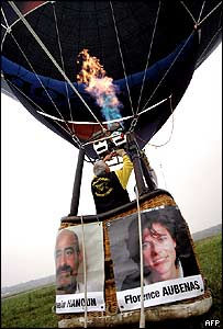 A hot air balloon carrying portraits of Florence Aubenas and her Iraqi guide Hussein Hanoun takes off in Courcelles-les-Montbeliard, south-eastern France.
