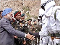 Prime Minister Manmohan Singh, left, shakes hands with soldiers, as Indian Army Chief Gen JJ Singh, second left, looks on.