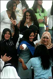 Kuwaiti women celebrate after women were granted the right to vote and stand in elections, 16 May 2005