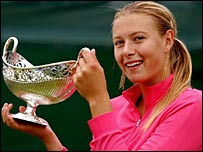 Maria Sharapova celebrates with the trophy in Birmingham
