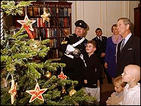 Prince Charles and young cancer sufferers decorating Christmas tree