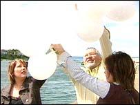 Lisa's family releasing balloons