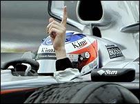 Kimi Raikkonen celebrates victory in the Canadian Grand Prix