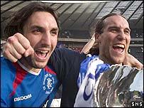 Sotirios Kyrgiakos and Dado Prso celebrate Rangers CIS Cup victory