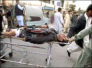 Volunteers carry an injured person at the bomb explosion site in Quetta, Pakistan