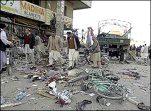Pakistani people inspect the site of the bomb blast in Quetta