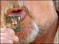 Bill Oddie licking first class stamp