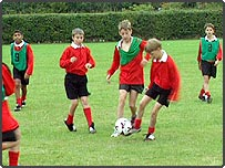 School children playing football