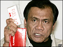 Samuel Ong, the dismissed deputy chief of the National Bureau of Investigation (NBI) displays an alleged master copy of an audio tape as he claims in a news conference Friday June 10, 2005