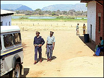 Police officers in Zimbabwe patrolling on a farm