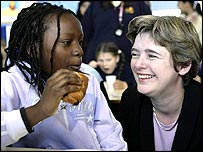 Ruth Kelly and pupil at school breakfast club