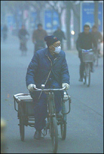 cyclist in the smog, AP