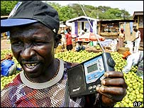 Market trader listens to radio