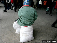 A migrant worker arrives at a train station on February 2005 in Beijing, China