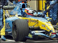 Fernando Alonso climbs out of his Renault in the Montreal pits after clouting the wall during the Canadian Grand Prix