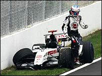 Jenson Button climbs out of his wrecked BAR druing the Canadian Grand Prix