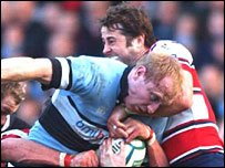 Blues centre Tom Shanklin is stopped by Gloucester's Andy Gomarsall