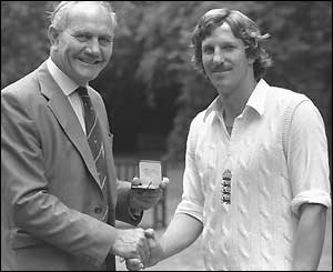 Botham receives a commemorative medal from Alec Bedser