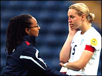 England manager Hope Powell consoles Faye White