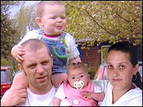 Andrew Brooks with his son Taylor, aged 18 months, daughter Macy aged three months, and partner Jodie Sefton.