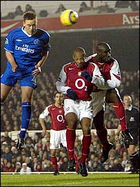 John Terry heads in Chelsea's first as Sol Campbell (right) is prevented from challenging him by team-mate Thierry Henry