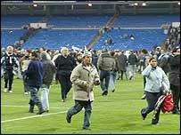 Spectators leave the stadium