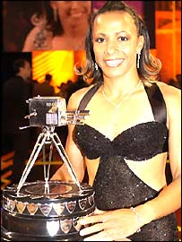 Kelly Holmes poses with her trophy
